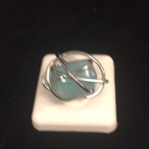 Stainless steel ring with blue stone